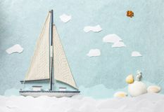 Segla yachten på pappers- bakgrund Arkivfoton