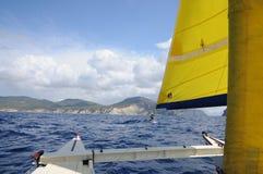 Seglingkatamaran med guling seglar i Ibiza Spanien Royaltyfria Bilder