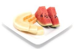 Segment av enmelon och en melon Royaltyfri Fotografi