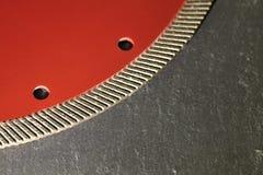 Segment of a diamond cutting disc on a background of gray concrete. royalty free stock photos