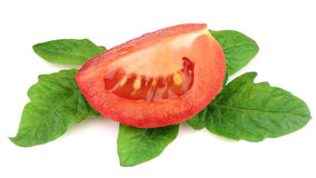 Segment juicy tomatoes with leaves Royalty Free Stock Photo