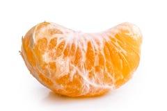 A segment of mandarin. A segment of mandarin isolated on white royalty free stock photos