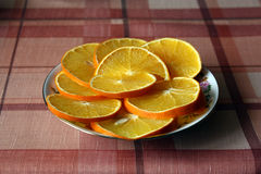 Segment of Oranges sitting on a plate Stock Photos
