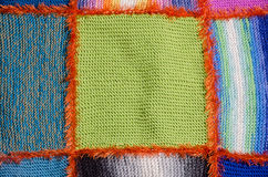 Segment of a quilt. Close-up of colorful blocks of a knitted quilt Royalty Free Stock Photography