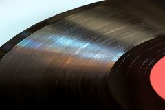 Segment of vinyl record with label close up. Multi-focus royalty free stock photo
