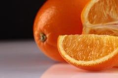 Segment and whole orange Royalty Free Stock Images