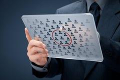 Segmentation. Marketing segmentation concept - businessman with futuristic glass tablet select segment (niche) of customers royalty free stock photo