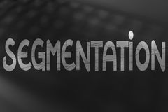 Segmentation text with dashed lines overlay over unfocused keybo Stock Photo