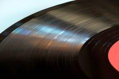 Segmento del disco de vinilo con cierre de la etiqueta para arriba Foto de archivo libre de regalías