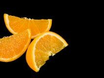 Segmentos suculentos da laranja do fruto fresco Imagens de Stock