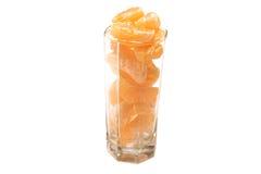 Segments de mandarine dans une glace Photographie stock libre de droits