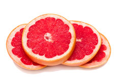 Segments of grapefruit. Four sections of ripe juicy grapefruit. Isolated Stock Images
