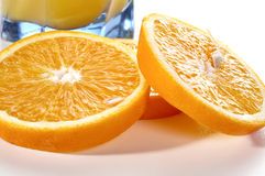 Segments of an orange and a glass of juice Stock Photo