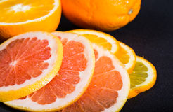 Segments of orange and grapefruit on a black background Royalty Free Stock Images