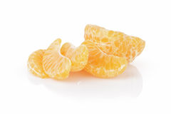 Segments of ripe tangerine Stock Photos