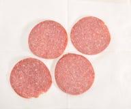 Segments of sausage  on a napkin. Segments of sausage lie on a napkin Royalty Free Stock Photo