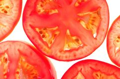 Segments of tomatoes. On a white background Stock Images
