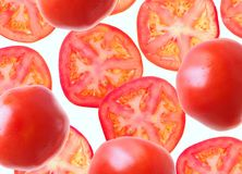 Segments of tomatoes. On a white background Royalty Free Stock Photos
