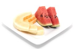 Segments of a water-melon and melon Royalty Free Stock Photography