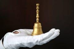 Segnalatore acustico di mano dorato Fotografia Stock