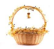 Segnalatore acustico dorato e cestino Fotografia Stock