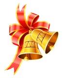 Segnalatori acustici di natale dell'oro con l'arco rosso Fotografie Stock Libere da Diritti