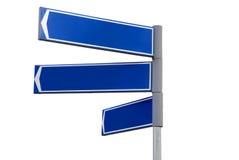 Segnale di direzione blu in bianco Fotografia Stock Libera da Diritti