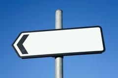 Segnale di direzione indicante di sinistra. Fotografia Stock