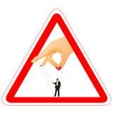 Segnale di pericolo con la holding di braccio del `s della donna un businessma Fotografie Stock Libere da Diritti