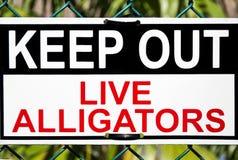 Segnale di pericolo degli alligatori fotografie stock
