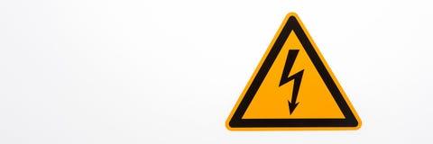 Segnale di pericolo del triangolo giallo ad alta tensione Fotografie Stock