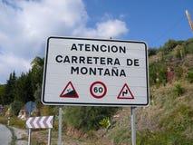 Segnale di pericolo della strada della montagna Immagini Stock Libere da Diritti