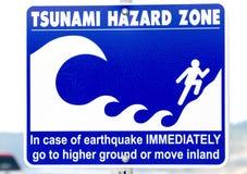 Segnale di pericolo di rischio di Tsunami fotografia stock