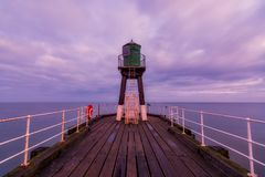Segnale North Yorkshire di Whitby West Pier Fotografia Stock