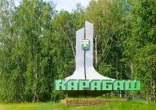 Segnale stradale all'entrata al Karabash Fotografia Stock
