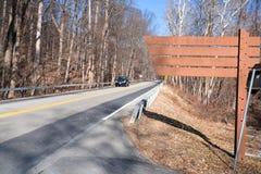 Segnale stradale di legno Fotografia Stock