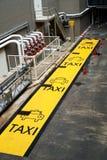 Segnale stradale giallo del tassì Fotografia Stock Libera da Diritti