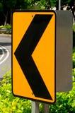 Segnale stradale marcato di girata di sinistra Fotografie Stock