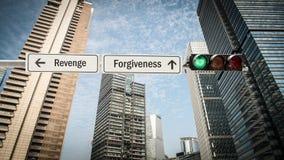 Segnale stradale a perdono contro vendetta fotografia stock