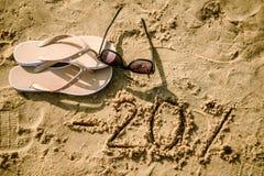 segnare 20 scritta sulla sabbia Immagine Stock