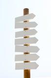 Segni di legno in bianco isolati su bianco Fotografia Stock