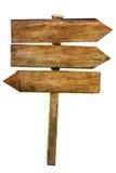 Segni di legno delle frecce della strada trasversale a più scelte isolati Fotografia Stock