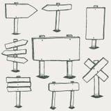 Segni di scarabocchio e frecce di legno di direzione Fotografia Stock