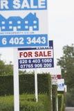 Segni di vendita di Real Estate Fotografia Stock Libera da Diritti