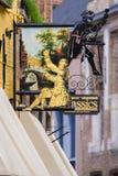 Segni fuori del negozio antico Bruges Immagine Stock Libera da Diritti