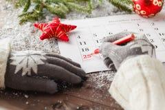 Segni il calendario della data per il Natale, il 25 dicembre, con festivo Fotografia Stock