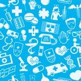 Segni medici su un fondo blu Fotografia Stock