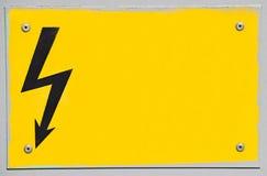 Segno ad alta tensione di elettricità Fotografia Stock