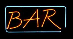 Segno al neon arancione della barra Fotografie Stock Libere da Diritti