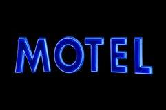 Segno al neon blu del motel alla notte Fotografia Stock